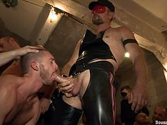With a gay guy bent over, two other gays poke at his asshole and one guy licks his balls and the tip of his cock. One of them is wearing leather gloves. Two hunks rub cocks together while another guy takes turns blowing them. It's time for a slut to get his asshole pounded while he sucks on dick.