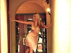 Charming blonde Alison Angel wearing a dress is having some nice time before going to a party. She moves her body seductively and then entertains herself by licking her tits.
