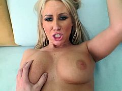 A motherfuckin' horny blonde bitch sucks on a hard cock and then gets it shoved balls deep into her fuckin' gash. Check it out!