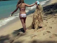 Captivating blonde Alison Angel is having a great time at a beach. She bathes and has fun and then takes her bikini off and demonstrates her hot body.