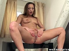 Hally Thomas has fun by herself in the bathroom. She rubs her pussy before she lets pee flow out of it. Next, she uses a pump to fill a dildo with pee and drink it.