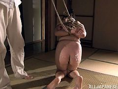She likes to be dominated and punished, so this guy does that to her. He tied up Sayoko and dripped hot wax on her ass. Sayoko is mouth gagged and she can't scream for help, not that she wants some. Hang around and see, how much this masochistic whore can endure!