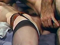 Light haired filthy tramps with eye catching titties came to please their long penised friend. They sucked it a bit and rode it passionately.Have a look at this dirty FFM fuck in The Classic Porn sex video!