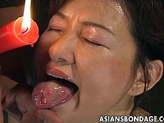 Check out this brunette mom! She's really receiving a treatment from this guy. He drips hot wax on her ass, boobs and even on her tongue. The bitch loves a good, hard punishment and that was only for the warm up! Wanna see what's next?