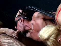 Blindfolded and completely naked the guy is being sexually used by two horny shemales. One of them has a whip to discipline the man whore and they both fed him their cocks. After sucking those dicks one of the shemales drills his asshole while the other one fucks his mouth. Lucky asshole gets fucked from both ends!