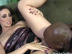 Stunning brown-haired babe sits on a sofa. Some Black dude comes up to her and takes his pans off. Paige starts to smile because a dick is big. She gives a blowjob and also gets her vagina licked.