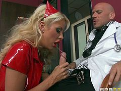 Nurse Courtney takes care of her patient as good, as she takes care of her doc. With a babe like her everybody is kept happy around here. The sensual and lustful blonde now set eyes on Sins, the doc. She gives him her special treatment, to make him more relaxed and sucks his cock with those superb red lips!
