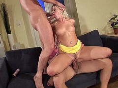 A sizzling blonde girl takes off her panties and toys her soaking wet pussy with a dildo. Then Cindy gets fucked in both holes simultaneously.
