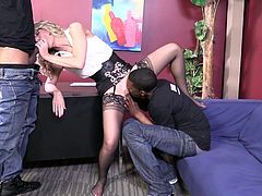 Mature blonde in stockings gets spit roasted by Black guys