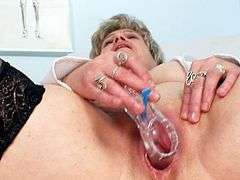 Watch mature nurse's puffy twat getting stretched in rough solo scene
