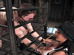 Sandra Romain is a mean slut, hot too! She caged Kade and know has some fun with his ass. The nasty slut spanks him and then ass drills the guy. She knows how to give him pain and pleasure but she enjoys more seeing the guy in pains. Stick around and see what else this Romanian slut will do to her sex slave.