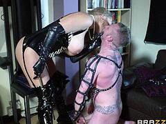 With her imposing boobs and her nasty attitude, Rebecca turned her husband into an obedient sex slave. The bitch made him wear a leather mask and costume and putted her man to work. After he cleaned the house under her strict supervision, the guy finally had a taste of her boobs and pussy before she gave him head