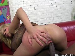Get a boner watching this short haired blonde, with small boobs wearing high heels, while she has interracial sex with a chubby black dude.