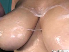 This very nice Japanese nurse oils up her big, natural tits then she gives her patient a titjob until he explodes all over her jugs.