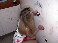 Pretty long haired blonde babe Casi James with sweet ass and sexy legs in colorful t-shirt takes on stiff cocks in glory hole both and gets boned deep in doggy style position.