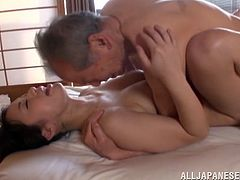 Get a load of this Asian babe's amazing breasts and her in credible ass as she's fucked by this old guy's hard cock in this amateur clip.