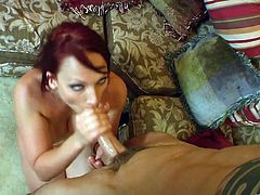 Redhead Nikki Hunter gets fucked by a younger guy on a sofa