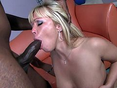 This blonde bitch gets her big butt all oiled up and gets fucked hard by a black dude with a big fuckin' cock. Hit play and check it out!
