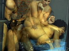 This fucker is in a cell where two hotties fuck him in the asshole with a motherfuckin' strapon, hit play and check it out right here!