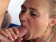Chubby grandma Sharon has a sweet ass and this guy, will take full advantage of it. She grabs his hard dick and enjoys that young piece of meat, sliding her lips on it. After sucking it hard, Sharon bends over and the guy pounds her booty from behind. Maybe, he will even give granny a load of jizz!