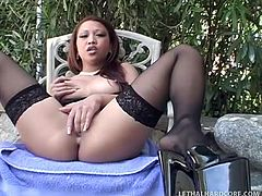 Chilling by the patio, this Asian babe rubs her beaver and flicks her clit. Sledge Hammer comes along and jacks his big black dick over her round ass. He thrusts his massive member into her cute mouth and she sucks him off from balls to shaft.