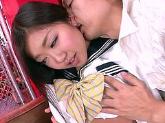 After her long day of studying in class, this cute schoolgirl meets up with her boyfriend. They sit on the couch and she kisses him passionately. This makes him really horny, so she lays back and lets him lick her nipples.