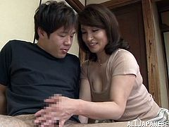 This fellow wakes up with a morning erection and he has never had one before. His step mom shows what he can do with it as she gives him a handy and blowjob. Then before long she's on top of him, kissing him and getting ready to give him some good sex.