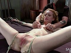 Jeze is a beauty, but she's a slut, so she ended up here at Sadistic Rope, the place where we tie up kinky whores really tight and give them a lesson! This time, the beautiful, milky white chick has been tied hard, with her legs spread wide and the executor fingered, and rubbed her pink pussy. Should he go rougher on her?