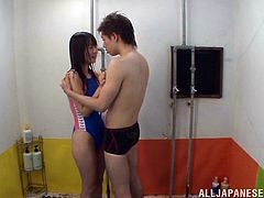 Check this Asian brunette, with a nice ass wearing a bathing suit, while she goes hardcore with a horny guy in different positions.