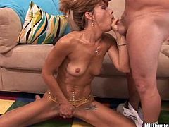 Skinny mature lady Tish is playing dirty games with some dude in the living room. She gives a blowjob to the stud and then sits down on his boner and jumps on it.