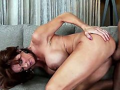 Heavy chested brunette cougar Deauxima with gigantic firm gazongas and smoking hot body catches young stud Ike Diezel playing with himself and enjoys riding on young buck all over living room.