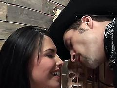 Black haired Danica Dillan with pierced belly button and nice natural boobies looks in the eyes randy cowboy with long hard sausage while he drills her wet pussy balls deep.