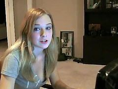 Beautiful long-haired blonde Aurielee is having fun in her room. She sits at her computer and watches some solo sex videos.