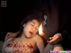 Yuki Mori is an Asian mommy who gives in to torture. Her master lights up a big red candle and pours wax all over her body. The emphasis is on her nipples and pussy.