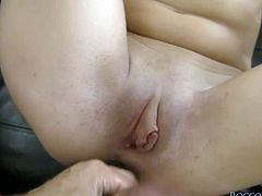 Cock craving brunette girl with cute face lies on her back desirably licking Rocco Siffredi's big hairy balls. Babe jerks off that giant cock with her both hands.