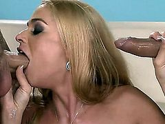 Resourceful Cathy Heaven is giving sizzling hot double blowjob during lusty threesome sex