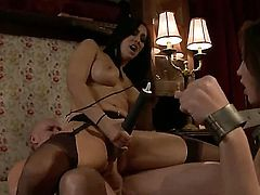 Mark Davis and Kelly Divine get kinky with their slave girl Isis Love. She is in chains and toyed with as she sucks cunt and gets drilled hard by a long, shaved cock.