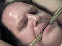 Sativa is a Mexican bitch with a really nasty attitude. She's turned on and mean so Anthony will have to stay there tied and take it like a good boy. The brunette begins by drilling his ass with her black strap on and pounds him merciless. It doesn't matter if it hurts him, she's just starting!