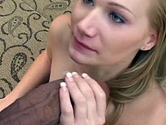 Slim blonde cutie Katie Ray shows her small tits to two black dudes. The guys face-fuck the bitch and then poke their fat weiners into her pussy.