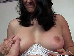 Chubby mature housewife Suzanne gets finger fucked up her pussy and ass by the photographer.See how she gets her clothes stripped out and then she enjoy getting her cunt fingered by him.