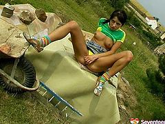 Dirty brunette Russian girl is masturbating outdoor with dildo