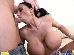 Horn-mad and lewd Lisa Lipps takes off her soccer girl outfit and shows her big boobs then blows her man and gives him nice titjob.