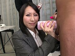 This exactly the kind of woman, every Japanese executive wants, working in his office. When entertaining clients the boss asks her to come over, she takes out one of the guy's cocks. Watch as she uses a masturbation sleeve on his cock, while giving a handjob.