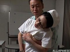A Japanese nurse in glasses gets seduced by one of the patients. This mature also wants to have sex, so she sits down on a table and gets banged in her wet cunt.