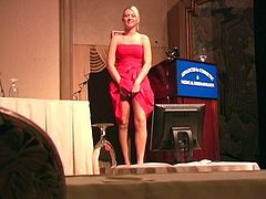 Entertain yourself by watching this blonde babe, with big nipples wearing a cute dress, while she masturbates in a solo model video.