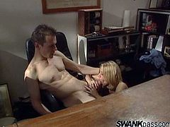 Take a nice look at this blonde lady, with natural tits wearing a miniskirt, while she gets badly screwed by a lusty guy in an office.