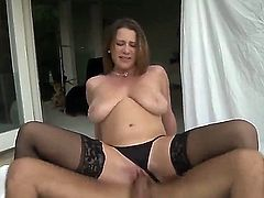 Turned on glamorous brunette Katerine with gigantic tits and great hunger for cock in black lingerie gives head to handsome Voodoo and gets his monster cannon up wet minge.