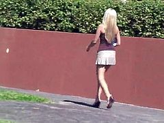 Check this long haired blonde, with a nice ass wearing a miniskirt, while she shows her intimate parts to the world in public outdoors.