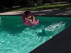 Young slender black haired slut Missy Maze with long pink nails and tight ass stretches her twat in backyard and goes in to pool to play with huge rubber dildo.