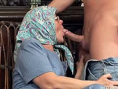 This old grandma is sitting at home knitting when one of her grandson's friends come over to her house to borrow some milk. She gives him a lot more than that and sucks on his cock while she plays with her old cunt.